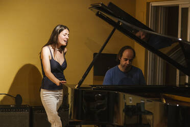 Singer and pianist in recording studio - LJF01736