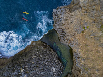 Two kayakers at Angel's billabong, Nusa Penida island, Bali,Indonesia - KNTF05111