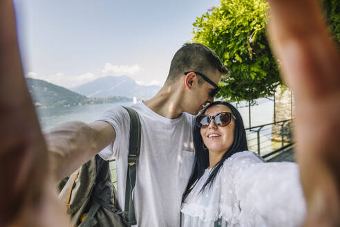 Happy young couple taking a selfie - MCVF00552