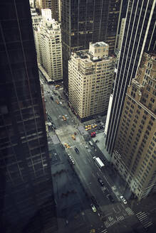 From above of street with vehicles driving among high rise buildings in center of New York city - ADSF09209