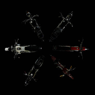 Top view of six vintage motorcycle with black background - SRSF00655