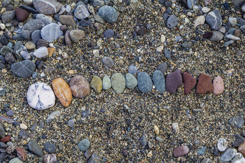 Close-up of pebbles on land at Greece - MAMF01282