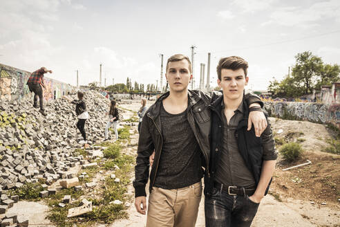 Portrait of cool teenage friends in an old run down industrial area - DHEF00219