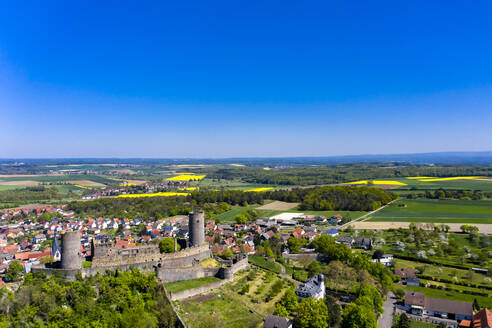 Germany, Hesse, Munzenberg, Helicopter view of Munzenberg Castle and surrounding village in summer - AMF08384