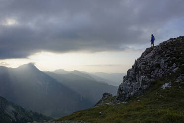 Hiker on viewpoint in the evening, Sulzspitze, Tyrol, Austria - MALF00057