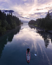 Man on sup board on Lake Plansee in the evening, Tyrol, Austria - MALF00111