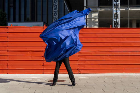 Anonymous man covered by blue cape - AFVF06941