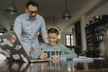 Fatherc helping son with his homework - MFF06035