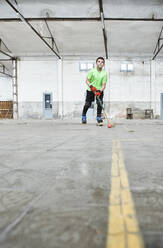 Surface level view of boy practicing roller hockey at court - VEGF02834