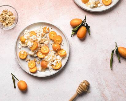 Dessert made of kumquats, fresh ricotta cheese, honey and walnuts - FLMF00276