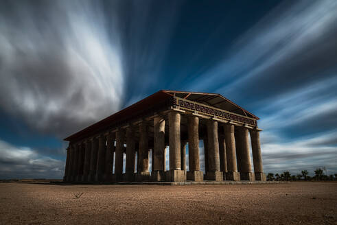 Picturesque long exposure view of ruin of ancient temple against cloudy sky - ADSF12768
