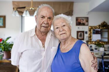 Senior couple looking at camera at home - GEMF04098
