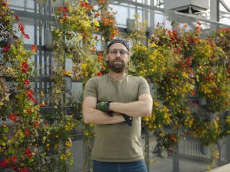 Portrait of a confident man in a greenhouse - JOSEF01572