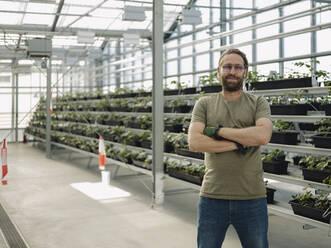Portrait of a confident man in a greenhouse - JOSEF01575