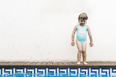 Little girl standing at pool edge - JRFF04714