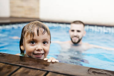 Little girl with her uncle in swimming pool - JRFF04720