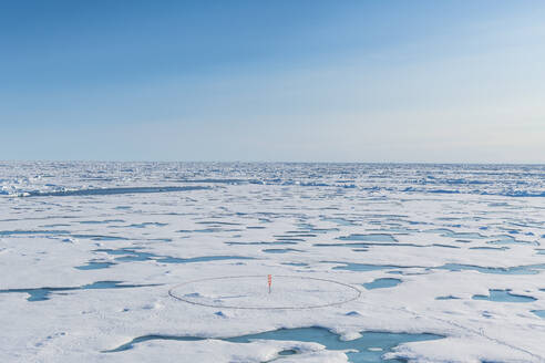 Aerial view of round marker set up on melting ice at North Pole - RUNF04139