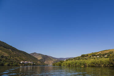 Clear blue sky over river Douro in summer - NGF00642