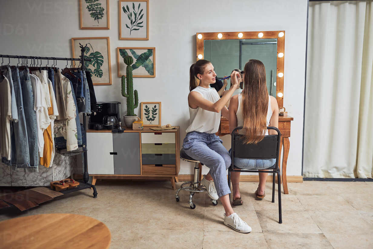 Positive Young Female Makeup Artist