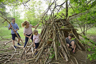 Family building camp together with log in forest - ECPF01046