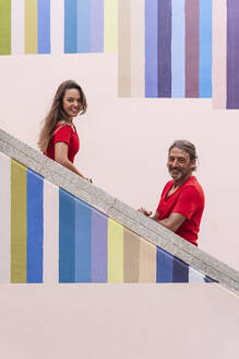 Father and Daughter on Color Wall/SPAIN/ALICANTE/ALICANTE - DLTSF01127