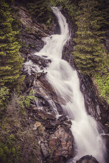 Long exposure of waterfall splashing in Central Eastern Alps - DHEF00370