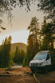 Camper van by riverbed during golden hour sunset near Aspen, Colorado. - CAVF88752