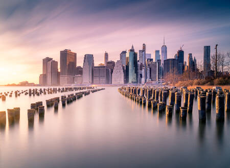 Manhattan skyline and poles of famous Brooklyn Bridge Park at sunset time - ADSF15495
