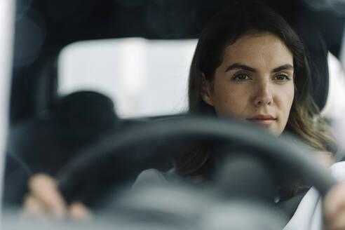 Young woman driving car - KNSF08521