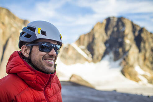 Climber smiling while enjoying the great outdoors. - CAVF88794