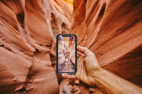 Taking picture with phone of narrow slot canyons in Escalante, Utah - CAVF88917
