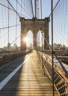 USA, New York, New York City, Brooklyn Bridge at sunrise - AHF00018