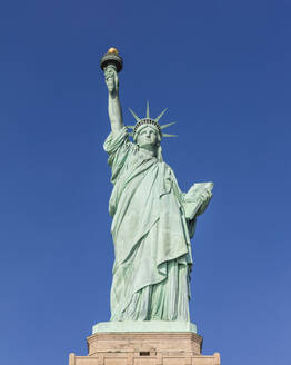 USA, New York, New York City, Statue of Liberty against blue sky - AHF00066