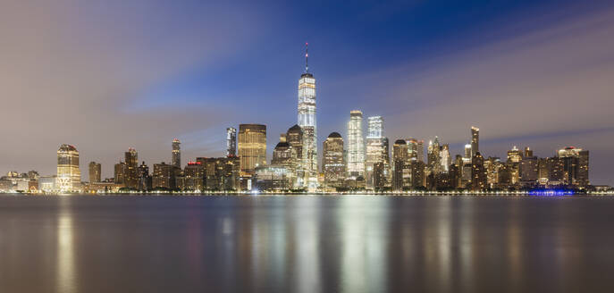 USA, New York, New York City, Lower Manhattan with One World Trade Center illuminated at dawn seen across river - AHF00078