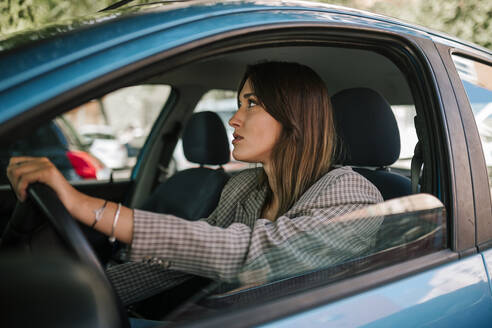 Young woman driving car - GRCF00381