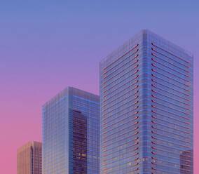 Modern glass skyscraper against sky at dusk, Osaka - LCUF00119