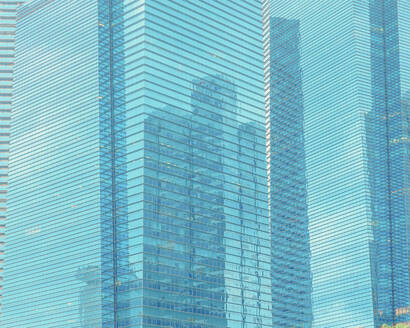 Reflection of skyscrapers on modern glass building - LCUF00128