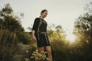 Mid adult woman trekking on footpath at Sierra De Hornachuelos, Cordoba, Spain - DMGF00156