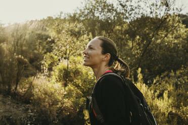 Smiling woman exploring Sierra De Hornachuelos, Cordoba, Spain - DMGF00159