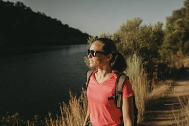 Woman admiring view of river while standing at Sierra De Hornachuelos, Cordoba, Spain - DMGF00162
