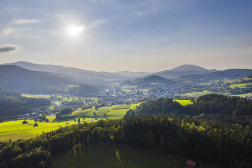 Drone view of sun shining over Lamer Winkel valley in summer - SIEF10062
