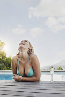 Young woman laughing on sunny day - RORF02403