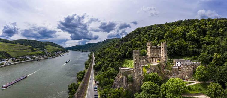 Germany, Rhineland-Palatinate, Trechtingshausen, Helicopter panorama of Rheinstein Castle and river Rhine in summer - AMF08571