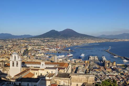 Italy, Campania, Naples, Certosa di San Martino museum and harbor in Gulf of Naples with Mount Vesuvius in background - ABOF00561