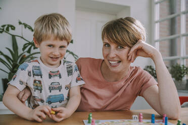 Mother playing with son board game at home - MFF06662