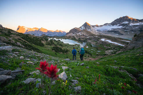 Couple Hiking Together During Sunset in Height of the Rockies - CAVF90106