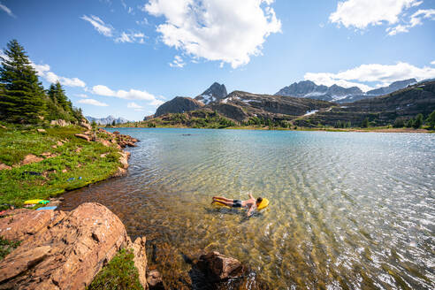 Swimming in Limestone Lakes Height of the Rockies Provincial Park - CAVF90115