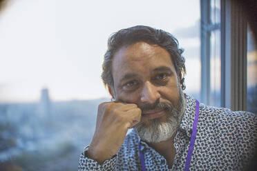 Portrait confident businessman at window - CAIF29944