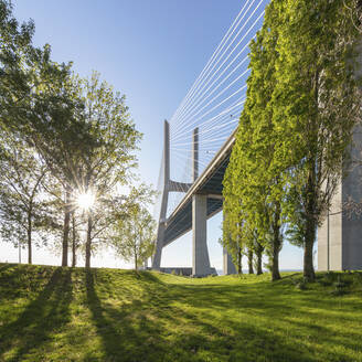 Portugal, Lisbon District, Lisbon, Sun shining over Vasco da Gama Bridge - AHF00197