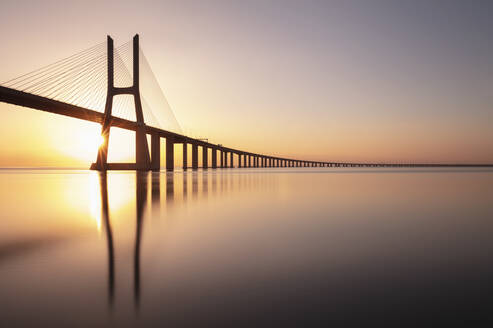 Portugal, Lisbon District, Lisbon, Vasco da Gama Bridge at sunset - AHF00206